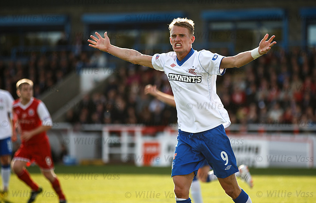 Dean Shiels politely suggests to the linesman that the ball had crossed the line for a Rangers goal