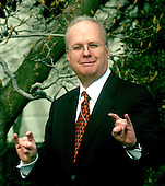 """Washington, D.C. - February 14, 2006 -- White House advisor Karl Rove makes the Texas Longhorn """"hook 'em horns"""" sign following the South Lawn ceremony where United States President George W. Bush welcomed the 2005 National Collegiate Athletic Association (NCAA) Division 1A National Champion Texas Longhorns to the White House in Washington, D.C. on February 14, 2006..Credit: Ron Sachs / CNP"""