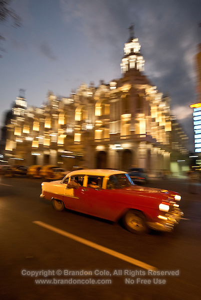 TH0235-D. A vintage American car cruises throgh Old Havana (Habana Vieja in Spanish). Havana, Cuba. Long exposure results in motion blur creative effect. <br /> Photo Copyright &copy; Brandon Cole. All rights reserved worldwide.  www.brandoncole.com