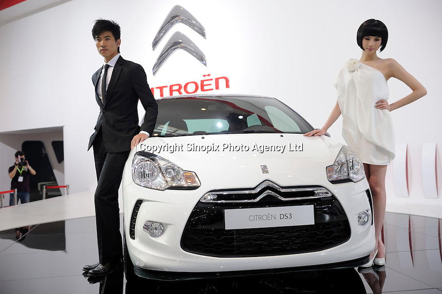 Model poses next to Citroen DS3 displayed at the Beijing Auto Show in Beijing, China. The car show has attracted all the world's major auto markers. China's vehicle sales have breached the 10-million barrier for the first time ever, with 10.9 million automobiles sold last year. .24 Apr 2010