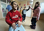 Bajram Kruezi plays a drum as other students dance to traditional Roma music in the Branko Pesic School, an educational center for Roma children and families in Belgrade, Serbia, which is supported by Church World Service. Kruezi's family came to Belgrade as refugees from Kosovo, and like many Roma can't afford regular school fees. Many Roma also lack legal status in Serbia, and thus have difficulty obtaining formal employment and accessing government services.