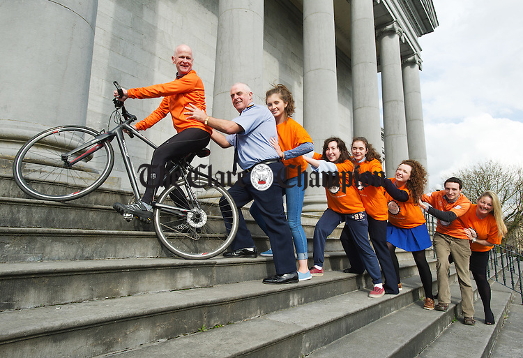 Fr Jerry Carey, event host, gets some helping hands from; Chief Supt. John Kerin, with Colaiste Muire transition year students Ciara Reidy, Aoibheann Mc Namara, Roisin Dwyer and Jaana Newman, as fellow hosts Cillian Griffey and Mary Howard add their support, at the Clare accommodation drive launch of Cycle Against Suicide which arrives in Ennis on May3rd at 5.30p.m. in Colaiste Muire. Photograph by John Kelly.