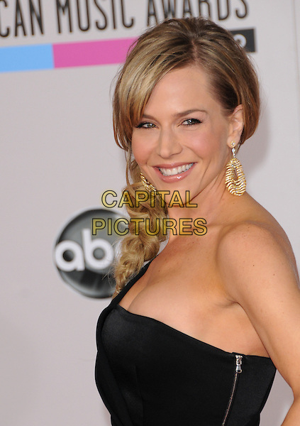 JULIE BENZ .At The 2010 American Music  Awards held at Nokia Theatre L.A. Live in Los Angeles, California, USA,.November 21st 2010..amas arrivals  portrait headshot side smiling gold earrings hair beauty  black one shoulder .CAP/RKE/DVS.©DVS/RockinExposures/Capital Pictures.