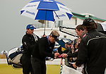 World number one, Luke Donald is keen to get his second round completed but is called off the range as another weather storm rolls in and there are further delays in completing the second round, but Luke still takes time to sign autographs for the hardy spectators who have stayed around to see the conclusion of the second round of the Barclays Scottish Open, played over the links at Castle Stuart, Inverness, Scotland from 7th to 10th July 2011:  Picture Stuart Adams /www.golffile.ie 9th July 2011