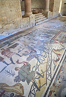 Wide picture of the Ambulatory corridor of the Great Hunt Roman mosaic and the entrance to the audience hall, room no 28, at the Villa Romana del Casale, first quarter of the 4th century AD. Sicily, Italy. A UNESCO World Heritage Site.<br /> <br /> The Great Hunt ambulatory is around 60 meters long (200 Roman feet) and connects the master&rsquo;s northern apartments with the triclinium in the south. The door in the centre of the the Great Hunt ambulatory leads to audience hall. <br /> <br /> The Great Hunt Roman mosaic depicts African animals being hunted and put onto ships to be taken to the Colosseum.