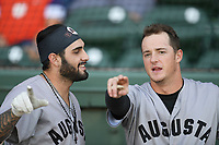 Left fielder Francisco Tostado (8), left, and shortstop Tyler Fitzgerand (6) of the Augusta GreenJackets talk before a game against the Greenville Drive on Thursday, August 29, 2019, at Fluor Field at the West End in Greenville, South Carolina. Augusta won, 11-0. (Tom Priddy/Four Seam Images)