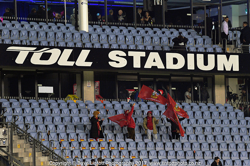 Lions fans wave flags in the grandstand after the 2017 DHL Lions Series rugby union match between the NZ Provincial Barbarians and British & Irish Lions at Toll Stadium in Whangarei, New Zealand on Saturday, 3 June 2017. Photo: Dave Lintott / lintottphoto.co.nz