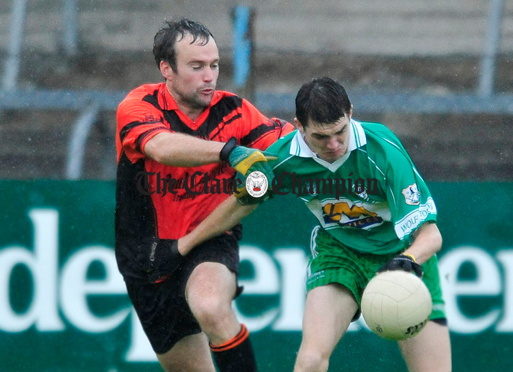 Ballyvaughan's Kieran Casey puts pressure on Kevin Cahill of Wolfe tones. Photograph by Declan Monaghan