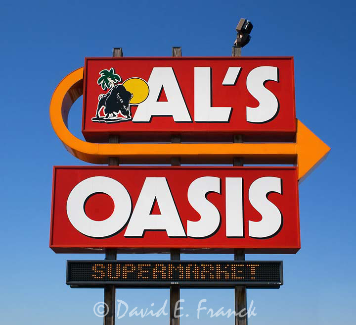 Sign for Als Oasis truck stop in Chamberlain South Dakota