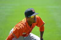 Tony Kemp (6) of the Fresno Grizzlies warms up in the outfield before the game against the Salt Lake Bees in Pacific Coast League action at Smith's Ballpark on June 14, 2015 in Salt Lake City, Utah.  (Stephen Smith/Four Seam Images)