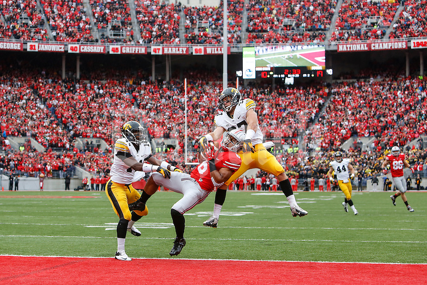 Ohio State Buckeyes wide receiver Evan Spencer (6) jumps for an unsuccessful pass during Saturday's game in Columbus, Ohio on Saturday, Oct. 19, 2013. (Jabin Botsford / The Columbus Dispatch)