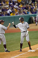 Texas A&M Aggies outfielder J.B. Moss (11) celebrates hitting a ninth inning triple in a Southeastern Conference baseball game against the LSU Tigers on April 23, 2015 at Alex Box Stadium in Baton Rouge, Louisiana. LSU defeated Texas A&M 4-3. (Andrew Woolley/Four Seam Images)