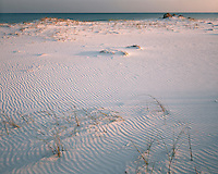 Evening light on the white sand beach on the Gulf of Mexico; Gulf State Park, AL