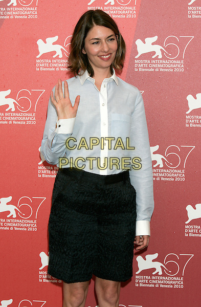 "SOFIA COPPOLA.""Somewhere"" photocall during the .67th Venice International Film Festival,.Venice, Italy, September 3rd, 2010..half length white shirt smiling director hand waving black skirt shorts blue striped pinstripe .CAP/PE.©Peter Eden/Capital Pictures."