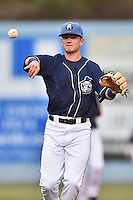 Asheville Tourists second baseman Forrest Wall (7) throws to first during game one of a double header against the Greenville Drive on April 18, 2015 in Asheville, North Carolina. The Tourists defeated the Drive 2-1. (Tony Farlow/Four Seam Images)
