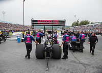 Oct 1, 2016; Mohnton, PA, USA; Crew members stand alongside the dragster of NHRA top fuel driver Antron Brown during qualifying for the Dodge Nationals at Maple Grove Raceway. Mandatory Credit: Mark J. Rebilas-USA TODAY Sports