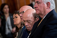 Wilbur Ross, U.S. commerce secretary, center, nods off next to Rex Tillerson, U.S. secretary of State, right, during a news conference with U.S. President Donald Trump and Stefan Lofven, Sweden's prime minister, not pictured, in the East Room of the White House in Washington, D.C., U.S., on Tuesday, March 6, 2018. Trump and Lofven are looking to focus on trade and investment between the two countries and ways to achieve shared defense goals. <br /> CAP/MPI/RS<br /> &copy;RS/MPI/Capital Pictures