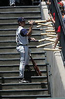 Round Rock Express Brooks Conrad on Bat day. Baseball bats. Round Rock Texas. Photo by Andrew Woolley / Four Seam Images.