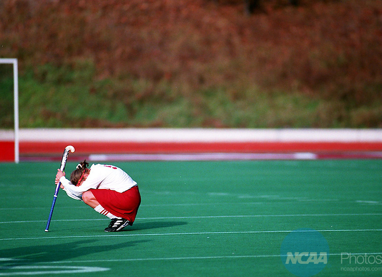Caption: 11 Nov 1996: Midfielder Diane Drumheller (51) of Lock Haven University sits alone in disappointment after the Division 2 Women's Field Hockey Championship at Charlotte Smith Field/Lock Haven University in Lock Haven, PA. The Bloomsburg Huskies Adler/NCAA Photos.