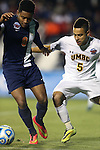 12 December 2014: Virginia's Darius Madison (9) and UMBC's Marquez Fernandez (5). The University of Virginia Cavaliers played the University of Maryland Baltimore County Retrievers at WakeMed Stadium in Cary, North Carolina in a 2014 NCAA Division I Men's College Cup semifinal match. Virginia won the game 1-0.