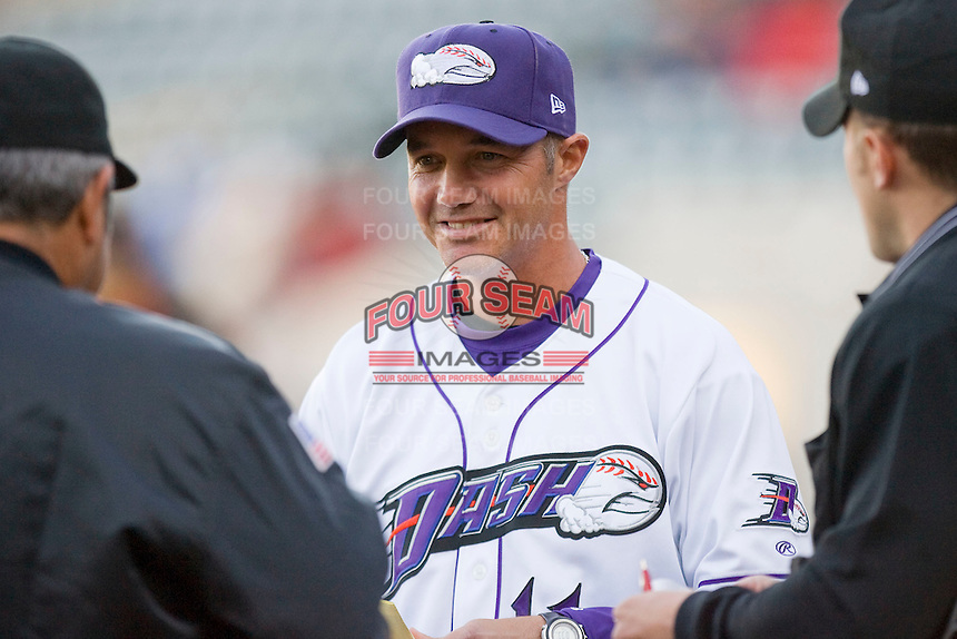 Winston-Salem Dash manager Joe McEwing #11 meets with the umpires at home plate prior to the start of the game against the Frederick Keys at  BB&T Ballpark April 28, 2010, in Winston-Salem, North Carolina.  Photo by Brian Westerholt / Four Seam Images