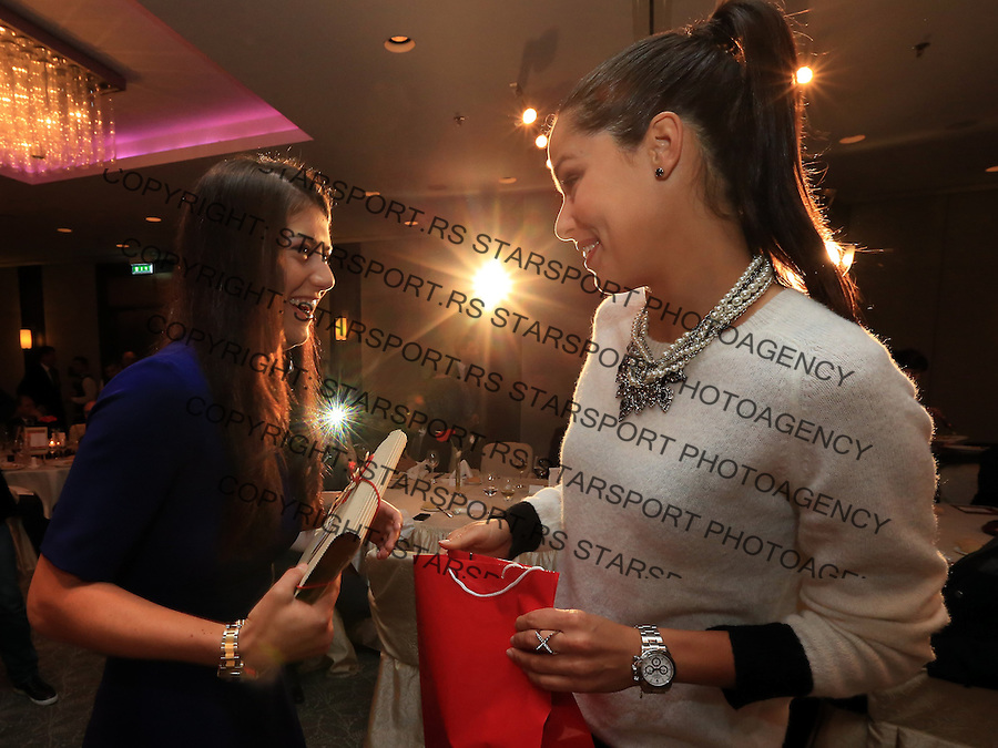 Tennis Tenis<br /> Fed Cup World Group play-off<br /> Rumunija v Srbija<br /> Sorana Cirstea (L) of Romania exchange gifts with Ana Ivanovic (R) of Serbia  during the Fed Cup official dinner ahead of the play off match between Romania and Serbia at hotel Intercontinental<br /> Bucharest, 04.17.2014.<br /> foto: Srdjan Stevanovic/Starsportphoto &copy;