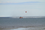 The Naomh Oisin fishing vessel, Clogherhead Lifeboat and the Coast Guard Rescue Helicopter during the rescue of two Razor Fishermen by the Coast Guard on Saturday 23rd August 2014.<br /> Picture:  Thos Caffrey / www.newsfile.ie