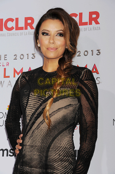 Eva Longoria<br /> 2013 NCLR ALMA Awards held at Pasadena Civic Auditorium, Pasadena, California, USA.<br /> 27th September 2013<br /> pressroom press room half length black sheer long sleeve dress hand on hip plait hair braid <br /> CAP/ROT/TM<br /> &copy;Tony Michaels/Roth Stock/Capital Pictures