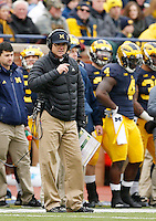 Michigan Wolverines head coach Jim Harbaugh coaches from the sideline during the NCAA football game against the Ohio State Buckeyes at Michigan Stadium in Ann Arbor on Nov. 28, 2015. Ohio State won 42-13. (Adam Cairns / The Columbus Dispatch)