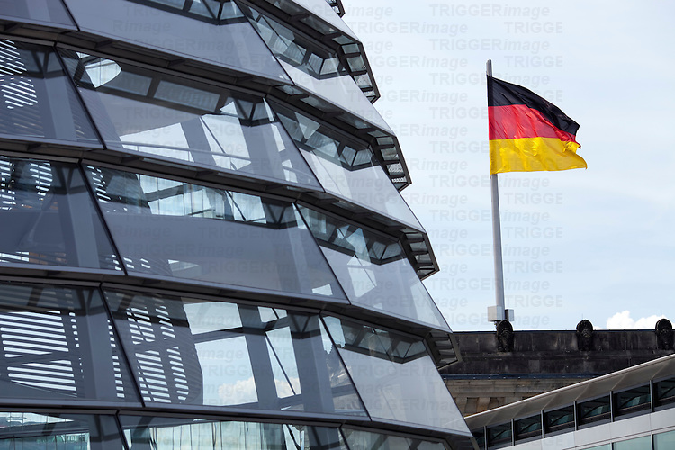 Reichstag roof dome and German flag, Berlin, Germany