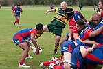 Kevin Farrell stretches a foot out to disturb Danny Tusitala's pass from the base of a scrum. Counties Manukau Premier Club Rugby game between Ardmore Marist and Pukekohe, played at Bruce Pulman Park Papakura, on April 16th 2011..Ardmore Marist won 23 - 16 after leading 23 - 6 at halftime.