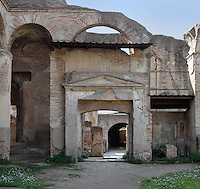 Entrance to the Terme dei Sette Sapienti (Baths of the Seven Sages), 2nd century AD, Ostia Antica, Italy. The pediment above the passageway is decorated with garlands and skulls of goats. Picture by Manuel Cohen