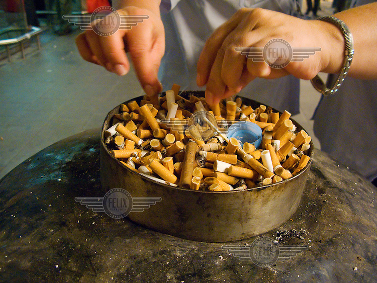 Full ashtray at the main exit of Brussels airport.
