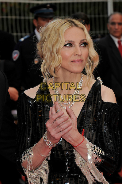 "MADONNA & GUY RITCHIE .Red Carpet Arrivals for the premiere of  ""I Am Because We Are"" at the Palais des Festivals  during the 61st Cannes International Film Festival, Cannes, France, May 21st 2008..half length earrings roots dyed hair diamond necklace sheer black sequined dress hands holding hand red kabbalah bracelet .CAP/PL.©Phil Loftus/Capital Pictures"