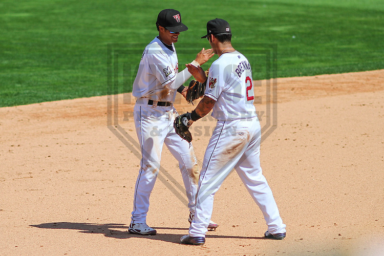 APPLETON - August 2014: Angel Ortega (10) and Taylor Brennan (2) of the Wisconsin Timber Rattlers during a game against the Beloit Snappers on August 26th, 2014 at Fox Cities Stadium in Appleton, Wisconsin.  (Photo Credit: Brad Krause)