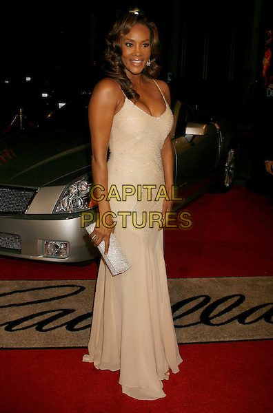 "VIVICA A. FOX.""Dreamgirls"" Los Angeles Premiere held at the Wilshire Theatre, Beverly Hills, California, USA..December 11th, 2006.full length cream yellow dress silver clutch purse.CAP/ADM/RE.©Russ Elliot/AdMedia/Capital Pictures"
