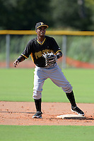 Pittsburgh Pirates shortstop Pablo Reyes (12) during practice before an Instructional League game against the Tampa Bay Rays on September 27, 2014 at the Charlotte Sports Park in Port Charlotte, Florida.  (Mike Janes/Four Seam Images)