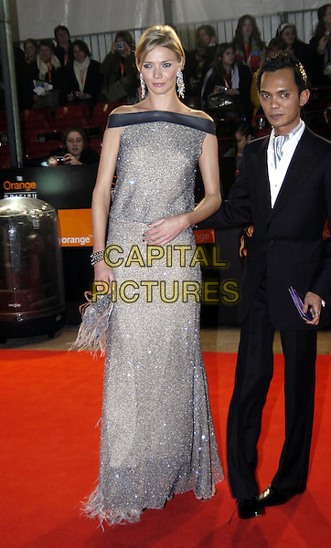 JODIE KIDD.Bafta Awards - British Academy Awards at Odeon Leicester Square.15 February 2004.full length, full-length, silver dress, off the shoulder.www.capitalpictures.com.sales@capitalpictures.com.©Capital Pictures