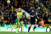 1st December 2019; Carrow Road, Norwich, Norfolk, England, English Premier League Football, Norwich versus Arsenal; David Luiz of Arsenal heads the ball clear from Teemu Pukki of Norwich City - Strictly Editorial Use Only. No use with unauthorized audio, video, data, fixture lists, club/league logos or 'live' services. Online in-match use limited to 120 images, no video emulation. No use in betting, games or single club/league/player publications