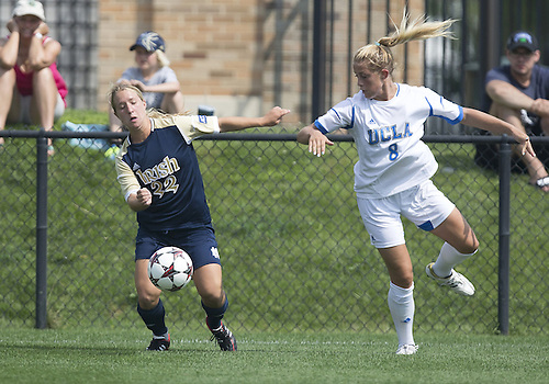 September 01, 2013:  Notre Dame forward Crystal Thomas (22) and UCLA defender Abby Dahlkemper (8) battle for the ball during NCAA Soccer match between the Notre Dame Fighting Irish and the UCLA Bruins at Alumni Stadium in South Bend, Indiana.  UCLA defeated Notre Dame 1-0.