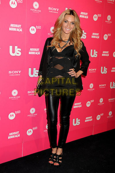 JASMINE DUSTIN.US Weekly Hot Hollywood Style Issue Event held at Drai's at the W Hollywood Hotel, Hollywood, California, USA..April 22nd, 2010.full length black leather trousers leggings sheer top cut out away clutch bag hand on hip.CAP/ADM/BP.©Byron Purvis/AdMedia/Capital Pictures.