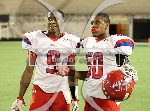 Manatee Hurricanes Trevon Walters #9 and Troy Griffin #60 pose for photos after the Florida High School Athletic Association 7A Championship Game at Florida's Citrus Bowl on December 16, 2011 in Orlando, Florida.  Manatee defeated First Coast 40-0.  (Photo By Mike Janes Photography)
