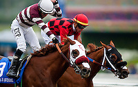 Willa B Awesome, with jockey Martin Pedroza aboard (left) defeats Reneesgotzip with Garrett Gomez (center) to win the 2012 Santa Anita Oaks at Santa Anita Park in Arcadia California on March 31, 2012.