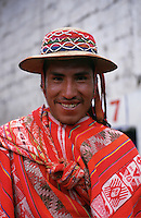 The weekly market at Pisac, in Peru's Sacred Valley of the Incas, draws big crowds from all the surrounding hill villages. Many of the visitors wear, like this man, traditional Indian clothing for their outing.
