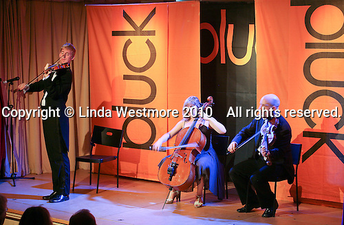 """""""Pluck"""" body theatre with music performing at Leconfield Hall, Petworth Festival, West Sussex."""