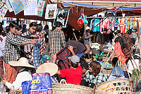 "Myanmar, Burma.  Clothing Market in the ""Five-Day"" Market, Inle Lake, Shan State."