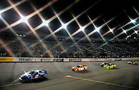 May 2, 2009; Richmond, VA, USA; (Editors Note: Special effects filter used in creation of this image) NASCAR Sprint Cup Series driver Kurt Busch (2) leads Kyle Busch (18) during the Russ Friedman 400 at the Richmond International Raceway. Mandatory Credit: Mark J. Rebilas-