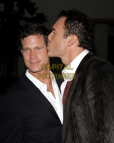DYLAN WALSH & JULIAN McMAHON .The FX Season 4 Premiere Screening of Nip/Tuck held at The Paramount Studios in Hollywood, California, USA..August 25th, 2006.Ref: DVS.Nip Tuck headshot portrait  kiss gesture.www.capitalpictures.com.sales@capitalpictures.com.©Debbie VanStory/Capital Pictures