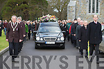 Killarney Mayor, Councillor Michael Gleeson leads the UDC guard of honour as the remains of the late Michael Cortney are taken from St Marys Cathedral on Saturday.
