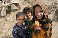 Refugee camp in South West Kabul Afghanistan near Charah Qambar. The refugees were from Sangine in the Helmund province of Afghanistan. They were also a few families from Kandahar. They had fled the fighting between the Taleban and Nato forces. On March 2nd there were chaotic scenes as refugees queued for aid (clothes and blankets) being distributed by an NGO.